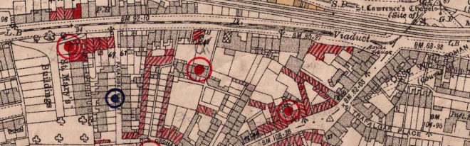Detail of bomb hits in 1942. Reproduced by kind permission of Bath Record Office. Red circle shows exploded bomb, Blue circle represents unexploded bomb.
